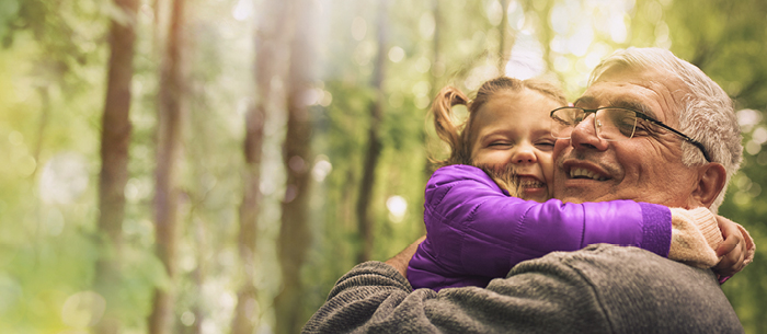 grandpa granddaughter nature forest happiness embrace hug family